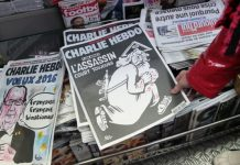 Charlie Hebdo blasted for migrant cartoon – again