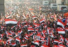 Thousands of Iraqis have defied a protest ban and rallied in the heart of the capital, Baghdad, to demand an end to sectarianism and corruption.