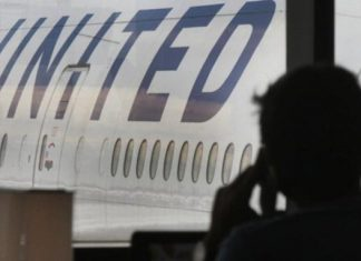 WATCH: Man forcibly removed from overbooked United flight