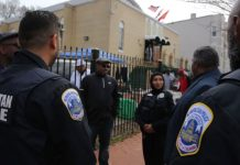 D.C. police officers stand guard at Masjid Muhammad mosque on Friday. (Oliver Contreras/for The Washington Post)