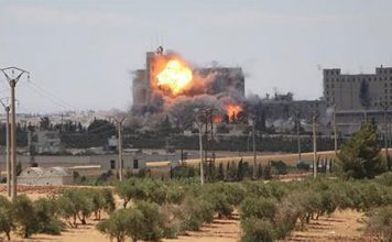 US-led air strikes kill 21 civilians in Syria