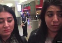 Two girls can barely hold back tears as they wait to find out if their Iraqi mother will be allowed into the United States