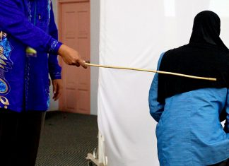 Two women were caned in front of 100 people in a shariah court in Terengganu on Sept 3 for attempting to commit lesbian sex. (Bernama pic)