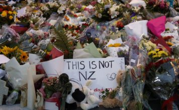 Vincent Yu | AP Flowers lay at a memorial near the Masjid Al Noor mosque for victims in March 15 shooting in Christchurch, New Zealand, March 16, 2019.